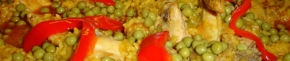 Food is decorated with pimentos and petit pois